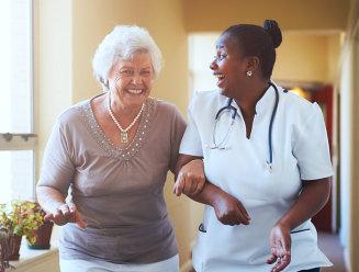 nurse and senior woman talking