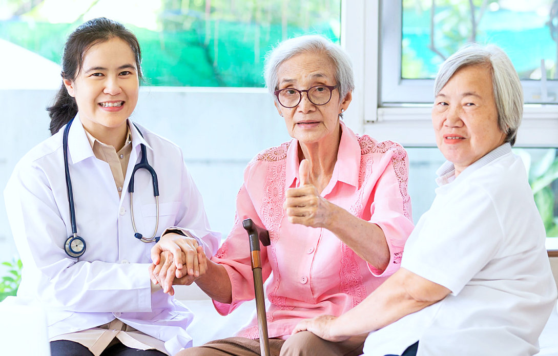 nurse smiling with senior women